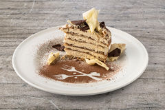 Tiramisu cake with white and dark chocolate flakes Stock Image