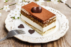 Tiramisu cake on white plate Royalty Free Stock Image