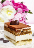 Tiramisu cake on white plate Royalty Free Stock Photography