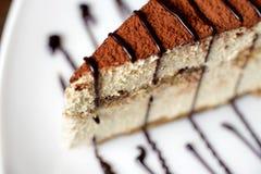 Tiramisu cake on a white plate Royalty Free Stock Image