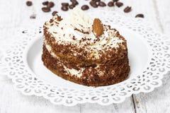 Tiramisu cake on white plate Stock Images