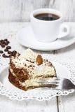 Tiramisu cake on white plate Stock Photo
