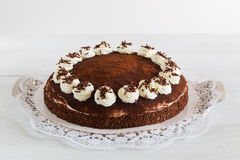 Tiramisu cake on white rustic wood Royalty Free Stock Image