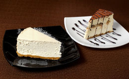 Tiramisu and cheesecake on a dark background Stock Image