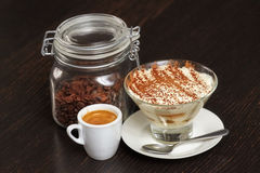 Tiramisu creme cake dessert in glass with mint leaves Royalty Free Stock Images