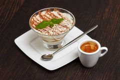 Tiramisu creme cake dessert in glass with mint leaves Royalty Free Stock Photos