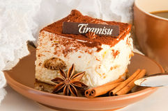 Tiramisu and a cup of coffee Stock Photos
