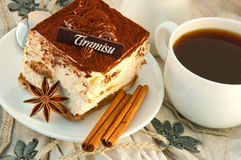 Tiramisu and a cup of hot coffee Stock Images