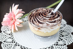 Tiramisu cupcake on lacy napkin Royalty Free Stock Images