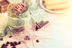 Tiramisu desert in round glass with lace ribbon, chocolate. Copy space royalty free stock photography