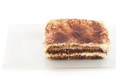 Tiramisu desseret op wit wordt geïsoleerd dat Royalty-vrije Stock Foto's