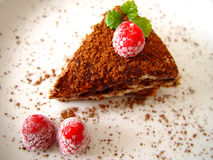 Tiramisu dessert. Served on plate with raspberries Stock Photo