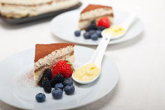Tiramisu dessert with berries and cream Stock Image