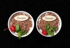 Tiramisu dessert on black background. Top view, with chocolate, decorated by cherry and mint Stock Photography
