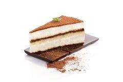 Tiramisu dessert. Tiramisu dessert on chocolate bar on white background. Italian sweet dessert concept Royalty Free Stock Photos