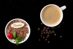 Tiramisu dessert, cup of coffee and beans. Tiramisu dessert, cup of coffee and coffee beans on black background Royalty Free Stock Photos