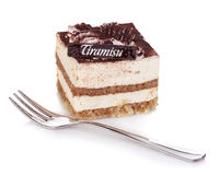 Tiramisu dessert with fork close-up on a white background Royalty Free Stock Photography