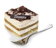 Tiramisu dessert with fork close-up on a white background Stock Images
