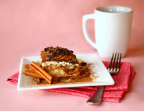 Tiramisu Dessert With Fork and Coffee Focus is on Royalty Free Stock Images