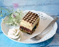 Tiramisu dessert with wildflowers Royalty Free Stock Image