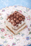 Tiramisu on a flower plate Royalty Free Stock Images