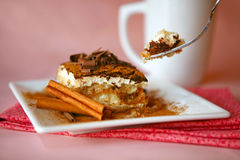 Tiramisu and Fork Focus is on Top of Dessert and F Royalty Free Stock Image