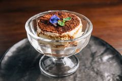 Tiramisu in glass cup is a coffee-flavoured Italian dessert. It is made of ladyfingers dipped in coffee. Tiramisu in glass cup is a coffee-flavoured Italian royalty free stock photography
