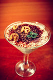 Tiramisu in glass decorated by walnut, toned Royalty Free Stock Photo