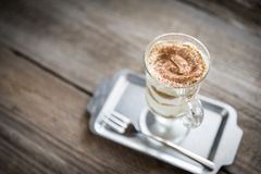 Tiramisu in the glass on the wooden background Stock Photography