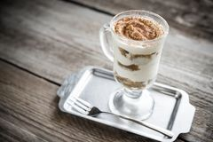 Tiramisu in the glass on the wooden background Royalty Free Stock Photos