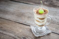 Tiramisu in the glass on the wooden background Stock Image