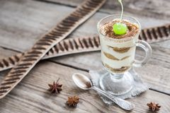 Tiramisu in the glass on the wooden background Stock Photos