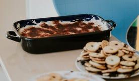 Tiramisu Italian dessert, black tray on table. School market table stock photography