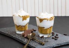 Tiramisu italian dessert in glasses with mascarpone cream and ch. Ocolate royalty free stock image