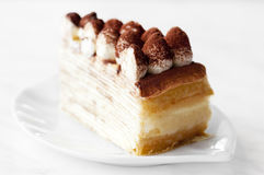 Tiramisu Mille crepe. Portion of Tiramisu Mille crepe on a plate Royalty Free Stock Photography