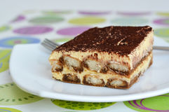 Tiramisu piece on white plate Royalty Free Stock Photography