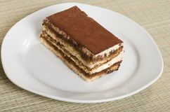 Tiramisu on a plate with a bamboo mat Royalty Free Stock Images