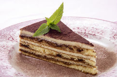 Tiramisu on a plate with mint Stock Photo