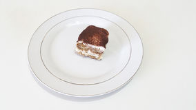 Tiramisu. Real italian tiramisu homemade in a white plate Royalty Free Stock Photo