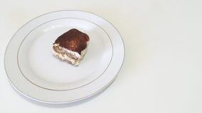 Tiramisu. Real Italian Tiramisu on a white plate Royalty Free Stock Photo