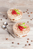 Tiramisu with red currant and chocolate in a glass Stock Image