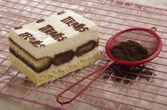 Tiramisu and sieve with cocoa Stock Photos
