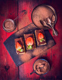 Tiramisu with strawberries and Chocolate powder, composing on red wooden background Stock Photography