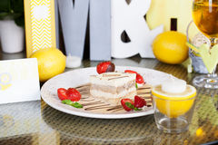 Tiramisu with strawberries on a plate lemon letter Royalty Free Stock Photography