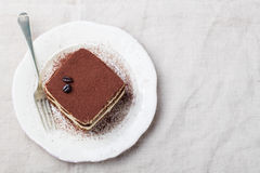 Tiramisu, traditional Italian dessert on a white plate Top view Stock Images