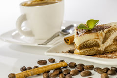 Tiramisu on white background. Italian desert tiramisu with coffe and cinnamon on white background stock photography