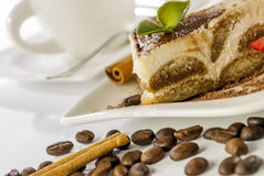 Tiramisu on white background. Italian desert tiramisu with coffe and cinnamon on white background stock photos