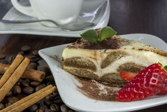 Tiramisu on wood table. Italian desert tiramisu with coffe and strawberry on wood table stock photography