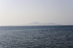 Tiran Island on the horizon. In the Red Sea Royalty Free Stock Image