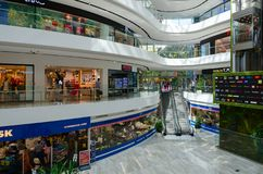 Interior of modern shopping center Toptani, Tirana, Albania. TIRANA, ALBANA - SEPTEMBER 6, 2017: Unknown people visit large modern shopping center Toptani Royalty Free Stock Images